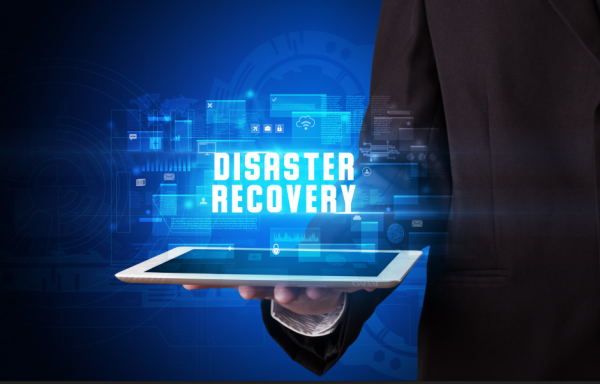 close up of man holding ipad with disaster recovery text